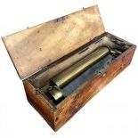 An early key-wind Swiss Cylinder Musical Box in a simple case.