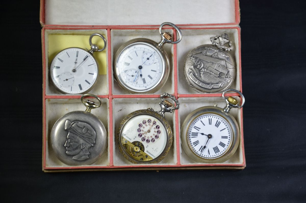Box with six pocket watches, one of which a chronograph. One silver key, one Hebdomas, one Roskopf,...