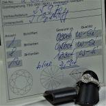 Bague en or gris richement pavée de diamants. Certificat.