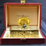 Singing bird box, gilded, with original box and key. Very good condition.