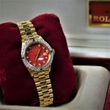 Lady's watch ROLEX in 18ct gold with diamonds and rubies. President wristband. With box....