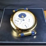 Table alarm clock with full calendar and seconds in the middle. Signed CARTIER. Very good condition.