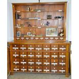 Pharmacy cabinet with 56 drawers and enameled lettering. Ca. 1900. 200x164x43cm