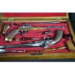 Paire de pistolets de duel avec accessoires complets, poudrier, bouchon de percussion, couteaux...