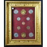 Collection encadrée de 10 médailles différentes PATEK PHILLIPE 53 x 42cm. Epoque 19e s.