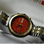 Gold and hardened steel automatic chronograph, manufactured for FERRARI, signed Il cavalino F1. With...