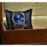 Wristwatch ROLEX Oyster Quartz. Completely made of steel. With calendar. Ø 36mm. Blue dial. With...