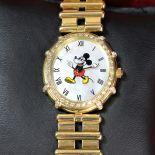 Montre dame GERALD GENTA avec cadran nacré représentant Minnie de Disney, or 83 g, 18ct,...
