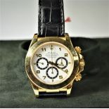ROLEX Daytona. 18ct gold. Diameter 40mm. Folding clasp. 2 wristbands. Like new. Box and papers