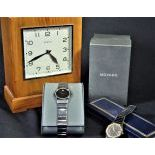 1 montre-bracelet Movado avec box original.1 montre-bracelet Lanco et 1 pendulette-tirelire Zénith...