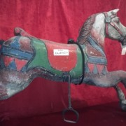 White wooden carousel horse, gray and red