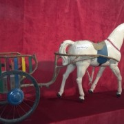 Horse harnessed to a cart